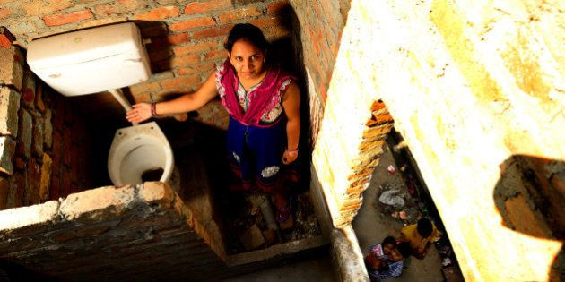 NEW DELHI, INDIA - SEPTEMBER 25: Building toilets in slums at Geeta Colony JJ cluster on September 26,...