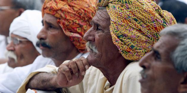 Protesting Indian Gujjar community members listen to a leader's speech during a demonstration in New...
