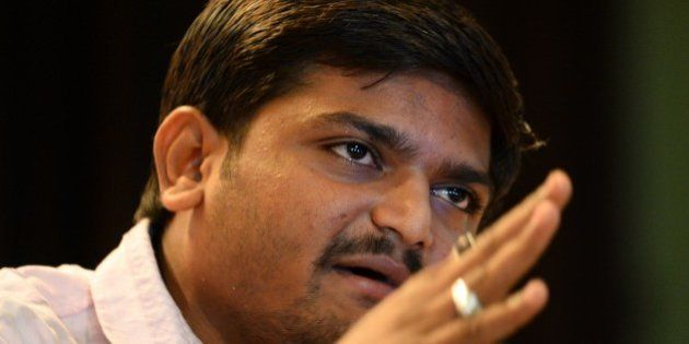 Indian convenor of the 'Patidar Anamat Andolan Samiti' movement Hardik Patel addresses a press conference...