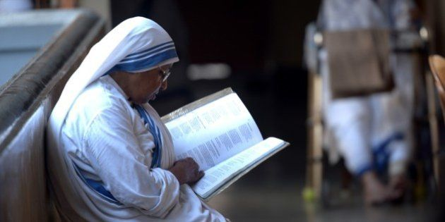 Indian nuns from the Catholic Order of the Missionaries of Charity take part in a mass to commemorate...