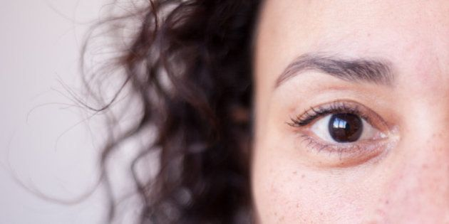 Close up of a woman's brown eye, strong selective