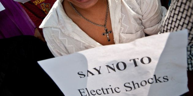 A mentally challenged youth holds a placard during a protest outside the Indian Health Ministry in New...
