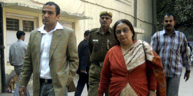 INDIA - NOVEMBER 27: Nitin Katara and Neelam Katara, brother and mother of Nitish Katara, in Patiala...
