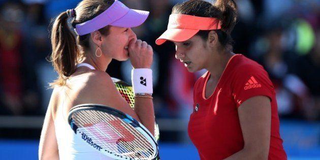 BEIJING, CHINA - OCTOBER 08: (CHINA OUT) Sania Mirza of India (R) and Martina Hingis of Switzerland in...