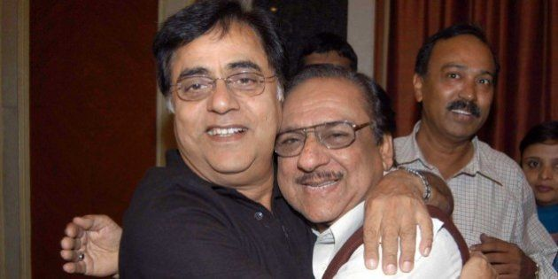 Ghazal singer Ghulam Ali, right, from Pakistan and  Indian ghazal singer Jagjit Singh, left, embrace each other as they arrive to address a press conference in Bangalore, India, Friday, March 4, 2005. The two maestro are due to perform here tomorrow. (AP Photo/Gautam Singh)