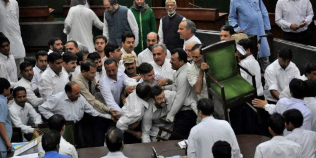 State lawmakers of the opposition People's Democratic Party scuffle with staff members of the house after...