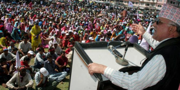 Communist Party of Nepal (UML) candidite K.P. Sharma Oli delivers his speech during an election campaign...