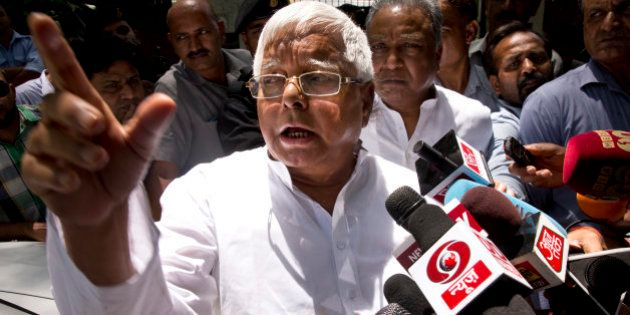 Rashtriya Janata Dal (RJD) leader Lalu Prasad Yadav speaks to reporters after a meeting with Samajwadi...