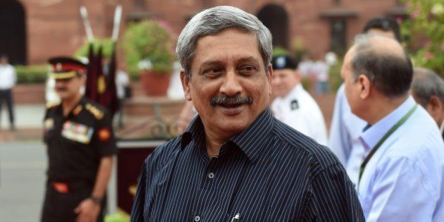 Indian Defence Minister Manohar Parrikar looks on as he waits to receive US Secretary of Defence Ashton...