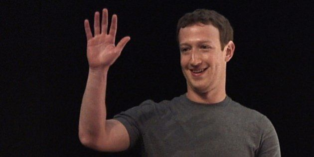 Facebook's creator US Mark Zuckerberg waves before speaking on the opening day of the 2015 Mobile World...
