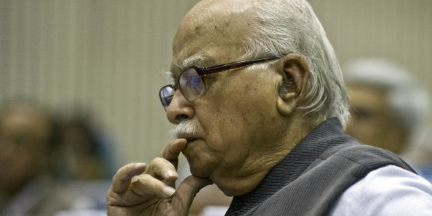 Bhartiya Janta Party (BJP) President L.K. Advani listens to Indian Prime Minister Manmohan Singh's speech...