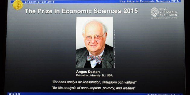 A portrait of US-British winner of the 2015 Nobel Economics Prize Angus Deaton is displayed on a tablet...