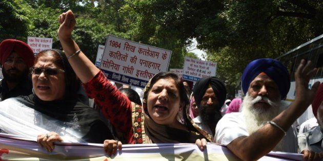 Indian Sikh women shout slogans against the Congress party of India and its President Sonia Gandhi during...