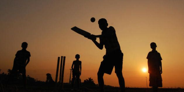 Indian boys play cricket during the last sunset for 2008 in Joypur near Agartala, the state capital of...