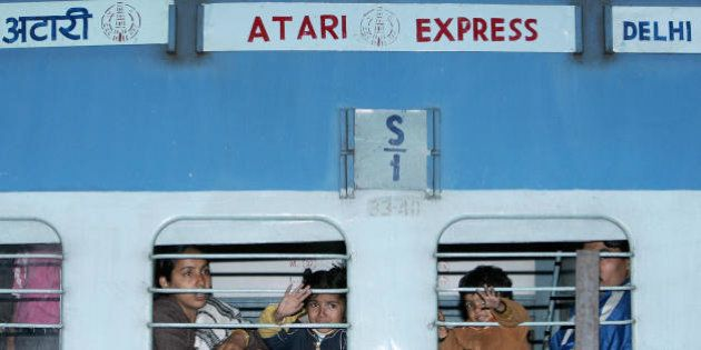 New Delhi, INDIA: Passengers travelling by the Samjhauta Express wave goodbye to relatives at the Old...