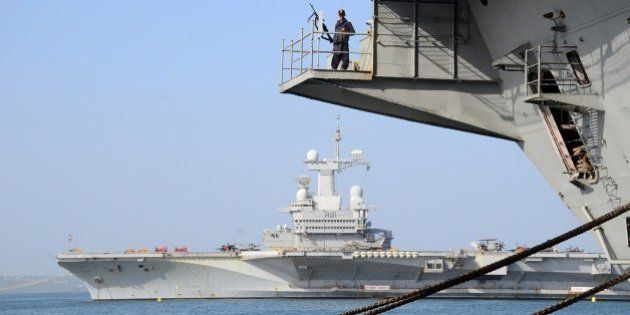 In this photograph taken on April 25, 2015, an Indian sailor stands alert on INS Viraat as France's aircraft...