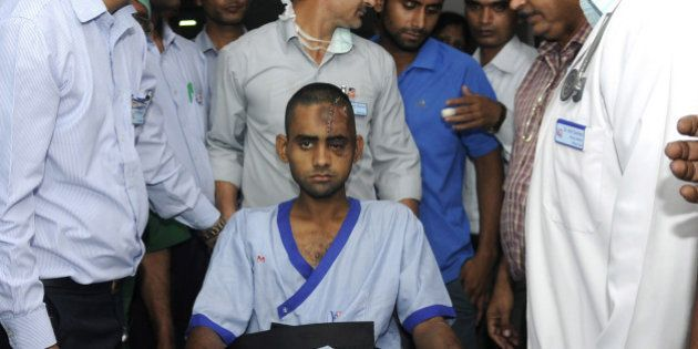 NOIDA, INDIA - OCTOBER 10: Dadri lynching victim Akhlaq's son Danish (22), being shifted to Army Research...