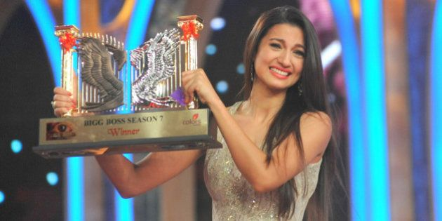 Indian model and actress Gauhar Khan poses with the Bigg Boss Season 7 reality television series trophy...
