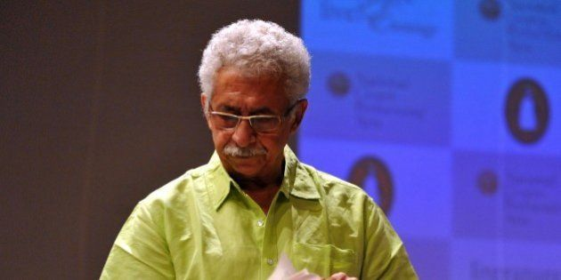 Indian Bollywood film and stage actordirector Naseeruddin Shah holds a copy of his newly released book...