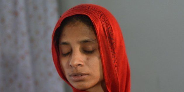 To go with Pakistan-India-missing-diplomacy,FOCUS by Ashraf KHAN This photograph taken on August 3, 2015 shows Indian woman Geeta performing rituals at a women's shelter run the Edhi Foundation in Karachi. Deaf and mute, Geeta has been stuck in Pakistan for 13 years, unable to return to her native India because she cannot remember or explain exactly where she's from. News of Geeta plight surfaced in 2012 but no progress was made in tracing her roots. AFP PHOTO/ RIZWAN TABASSUM (Photo credit should read RIZWAN TABASSUM/AFP/Getty Images)