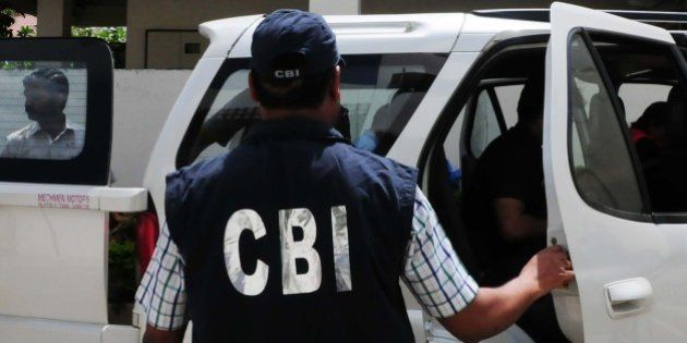 BHOPAL, INDIA - SEPTEMBER 24: CBI officials coming out of the residence of main accused in Vyapam scam...