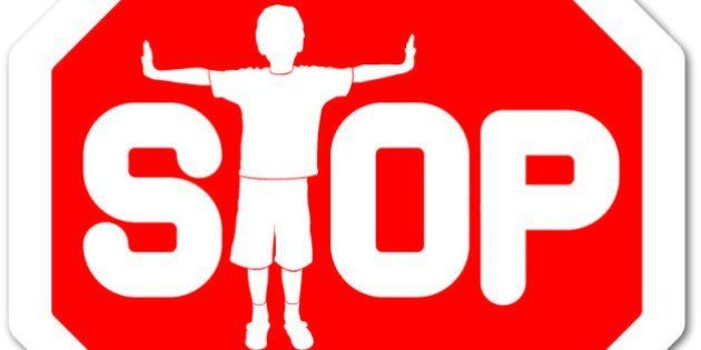 red sign stop with boy as letter