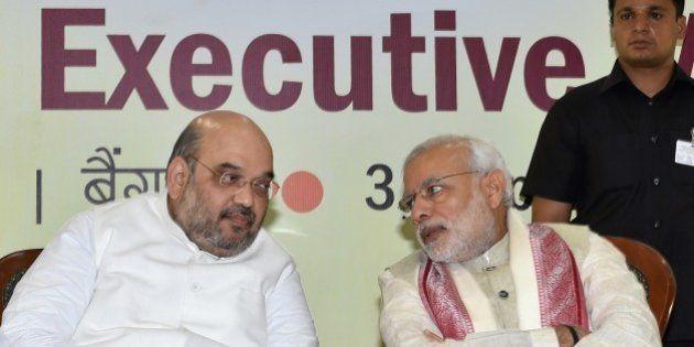 Indian Prime Minister Narendra Modi (R) and Bharatiya Janata Party (BJP) National President Amit Shah...