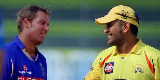 Captains of Rajasthan Royals' Shane Warne, left, and Chennai Super Kings' Mahendra Singh Dhoni interact...