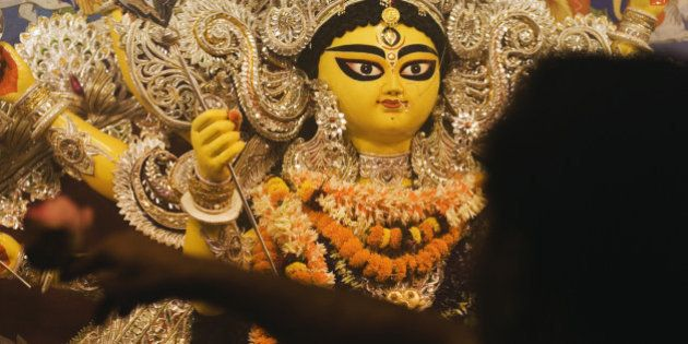 Pandit praying in front of goddess Durga, Kolkata, West Bengal,