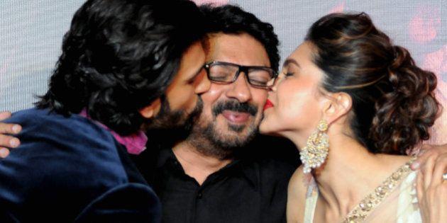 Indian Bollywood film actors Ranveer Singh (L) and Deepika Padukone attend their first look trailer launch...