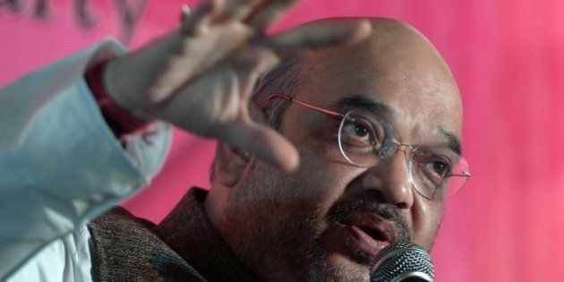 President of India's Bharatiya Janata Party (BJP) Amit Shah gestures as he addresses business leaders...