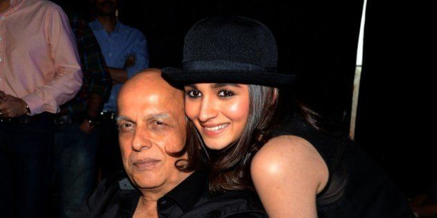 Indian Bollywood film actress Alia Bhatt (R) poses with her father, director Mahesh Bhatt during the...