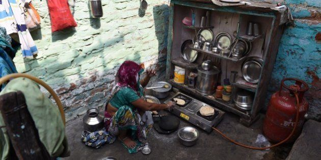The grandmother of a four-year-old girl who was raped prepares food at her house in a slum in New Delhi...