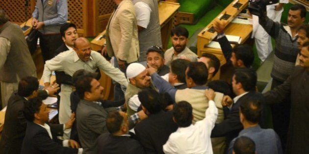 Independent lawmaker, Engineer Rashid (CL) shouts after being thrashed by Bhartiya Janta Party (BJP)...