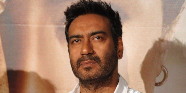 Indian Bollywood actor Ajay Devgn poses during the poster and song launch of the upcoming Hindi film...
