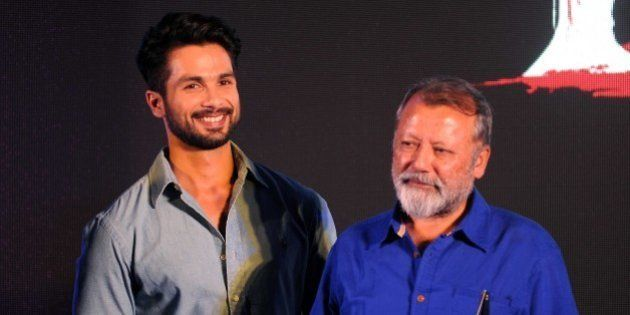 Indian Bollywood actors Shahid Kapoor (L) and Pankaj Kapur pose for a photograph during a promotional...