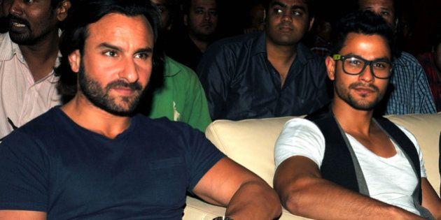 Indian Bollywood actors Saif Ali Khan (L) and Kunal Khemu (R) pose for a photo during the upcoming Hindi...