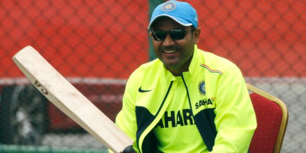 India's cricketer Virender Sehwag sits during a training session ahead of their ICC Twenty20 Cricket...