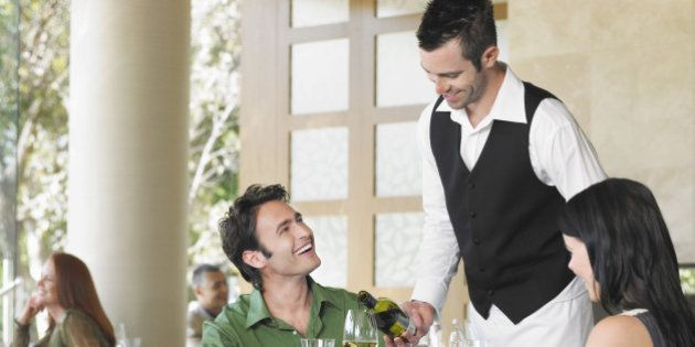 Waiter Serving Couple in