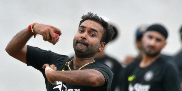 Indian cricketer Amit Mishra delivers a ball at a practice session at the R Premadasa International Cricket...