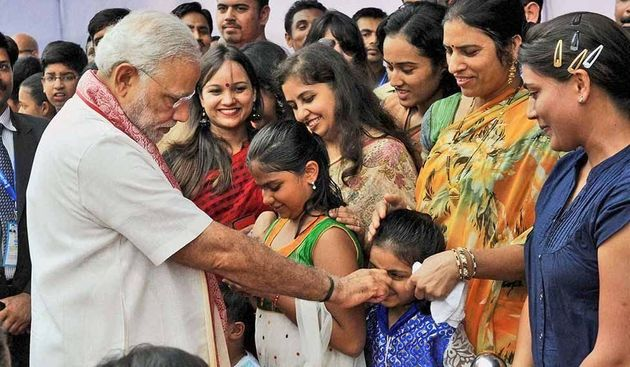 PHOTOS: PM Modi Is A Pro At Making Kids