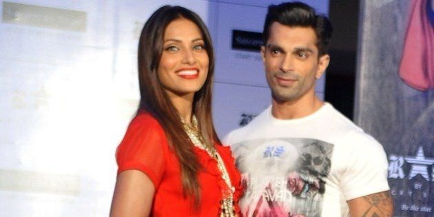 Indian Bollywood actress Bipasha Basu (L) poses with actor Karan Singh Grover during the launch of designer...