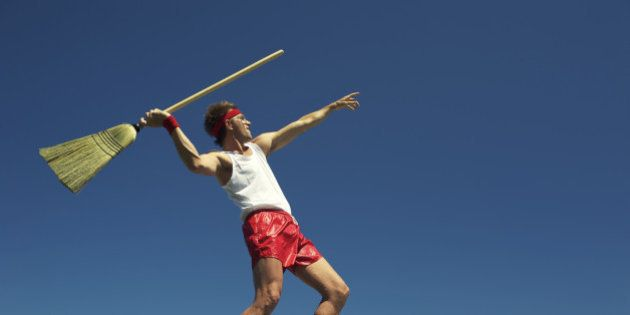 Nerdy man throws broom as javelin in his own special version of a track and field