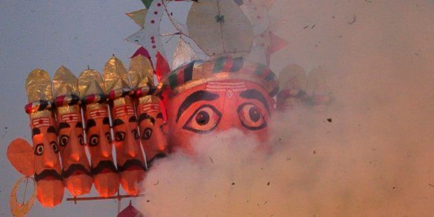 Smoke rises as an effigy of the ten-headed demon king Ravana burns during Dussehra celebrations in New...