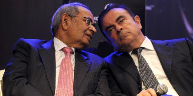 CEO and chairman of Renault-Nissan, Carlos Ghosn (R) and co-chairman of Hinduja Group, G.P. Hinduja share...