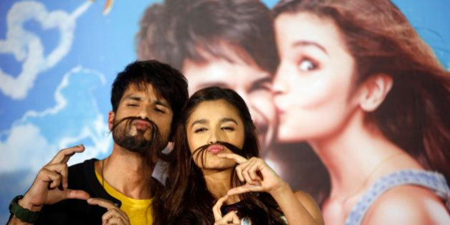 Bollywood actors Shahid Kapoor, left and Alia Bhatt pose for the media during the trailer launch of their...
