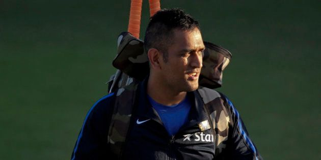 Indian cricket captain Mahendra Singh Dhoni leaves after a practice session on the eve of their first...