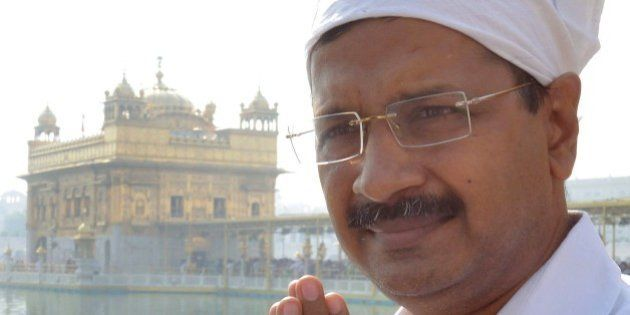 Delhi chief minister, Arvind Kejriwal pays his respects at the Golden temple in Amritsar on October 24,...