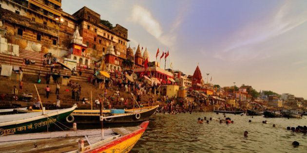 Pilgrims bathing in River Ganga in holy city of Varanasi, in