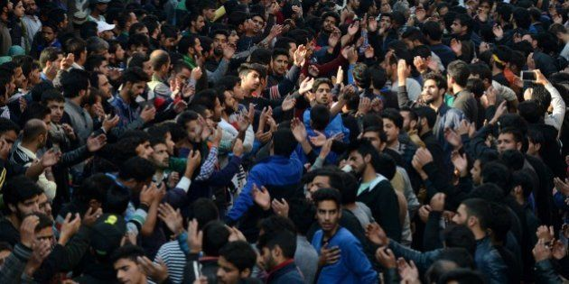 Kashmiri Shiite Muslim devotees shout religious slogans during a religious procession held ahead of Ashura...